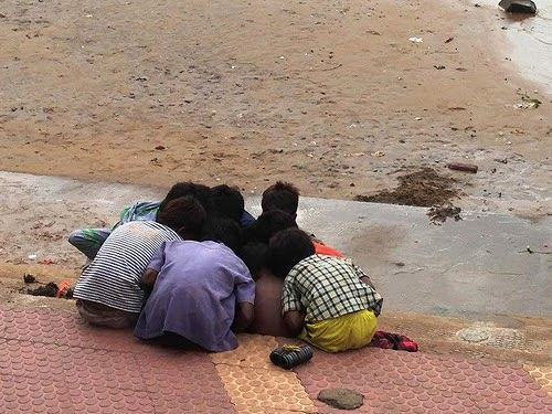 A group of young boys gambling with coins gathered from River Godavari in Rajahmundry, Andhra Pradesh. Don't miss the bunch of magnet rings they use ...