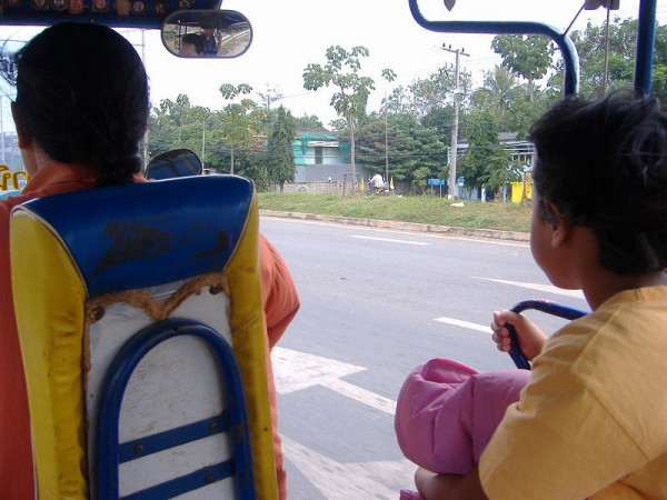 A woman driver with her daughter