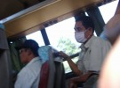 A passenger wearing a mask in the bus