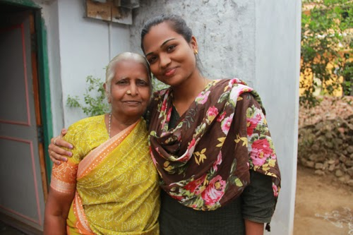 Gayathri (left) is a 'successful migrant' and is helping renovate the lavatories in the primary school in Melmayil