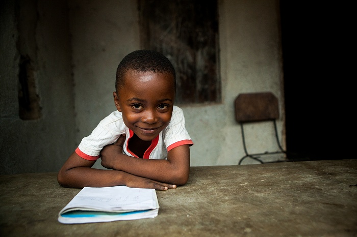A studying child in Sierra Leone