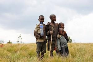 Children holding a bottle of water, Burundi